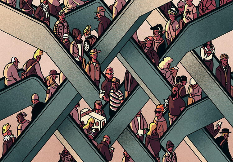 People crowd escalators.